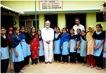 Dr.Ahmed in front of school in Nazerabad Tumkur, India which he built in 1967 incorporation with the United States Peace Corps.