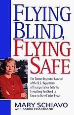 Cover has a small head and shoulders photo of the author, a short-haired blond woman with arms folded.