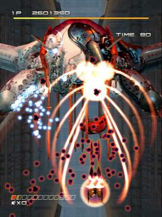 Ikaruga - A player uses the homing laser attack while in black form. White bullets are approaching from the left.