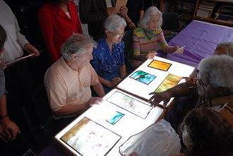 Queens Museum - Seniors at an educational program