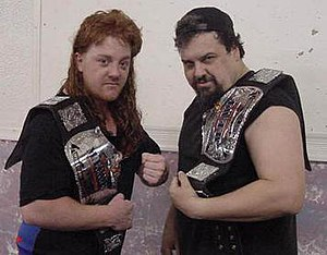 "MEWF Tag Team Championship - The Hollywood Hunks (Lucifer and ""Hollywood"" Bob Starr) as MEWF Tag Team Champions."