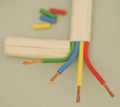 White-coated cable, cut away to show green, blue, yellow and red coated wires
