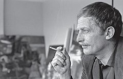 Black and white photograph of Alejandro Obregón in profile smoking a cigarette.