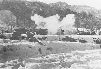 Soldiers charging into thick smoke