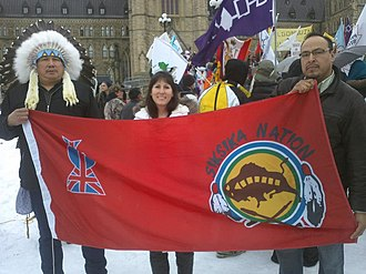 Siksika Nation - Two members of the Siksika Nation from southern Alberta  and a local non-Aboriginal supporter in Ottawa on January 11th 2013 for the Idle No More protest movement