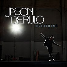 "Derulo standing in a warehouse with his arms out wide, as a bright light on the left side of the cover shines down on him. Above him are the words ""Jason Derulo"" and ""Breathing""."