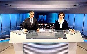 Jornal Nacional - William Bonner (left) and Renata Vasconcellos (right), main hosts.