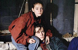 Mandy Salter - Mandy (left) and Aidan were the focus of a storyline on teenage homelessness. Here the characters are depicted squatting in a maintenance room, on the roof of a block of flats (1993).