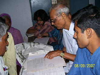 West Bengal National University of Juridical Sciences - Members of the Legal Aid Society, assisted by teachers, offering free legal help at Midnapore.