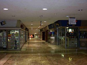 PATH (Toronto) - An underground shopping area in the financial district. (The PATH signage is shown hanging from the ceiling on the upper right side of the photo)