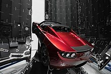 Tesla roadster 2008 wikipedia elon musks tesla roadster mounted on its payload fairing prior to being launched into space aboard the falcon heavy multi stage rocket fandeluxe Images