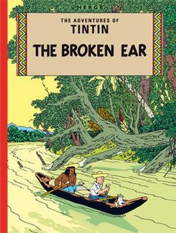 Book cover. Tintin and Snowy are in a canoe on a jungle river.