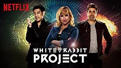 The three presenters standing together. Netflix logo is prominently shown on the top left. At the bottom in stylized white writing is the show title. A rabbit symbol appears between the words white and rabbit.