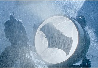 Bat-Signal - The Bat-Signal in the 2016 film Batman v Superman: Dawn of Justice, with Ben Affleck (left) as Batman