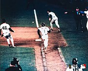 Game 6: Ray Knight (not pictured) scores the winning run as Bill Buckner and Bob Stanley watch Mookie Wilson's slow roller.