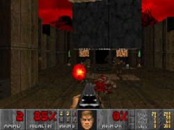 The player is cocking their shotgun after downing one monster while others approach. A man's face is grinning in the bottom strip showing the player's stats.