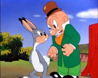 Elmer Fudd - Elmer Fudd, resembling Egghead early in his career, is annoyed by a rabbit in Elmer's Candid Camera.