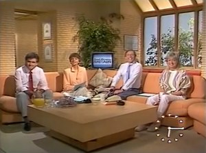Good Morning Britain (1983 TV programme) - Opening shot of the programme from 1986. This shows the main set, and (from left to right) presenters Richard Keys, Anne Diamond, Nick Owen and Wincey Willis. The on-screen clock can be seen at the bottom-right.