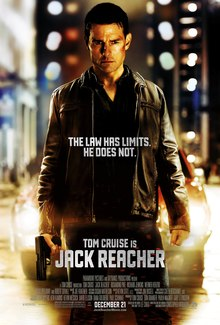 The poster shows a man, injured and holding a gun, standing in front of a car. Text at the bottom reveals the tagline and in bottom reveals the film's main actor and title, credits, rating and release date.