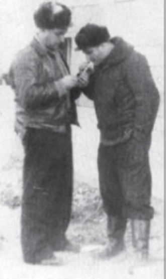 256th Fighter Aviation Regiment - 256th IAP navigator and pilot Viktor Kalmanson and 523rd IAP ace Grigory Okhay at Miaogou airfield, February 1952