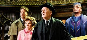 Ministry of Magic - Some Ministry officials in Harry Potter and the Order of the Phoenix, from left to right: John Dawlish, Auror; Dolores Umbridge, Senior Undersecretary to the Minister; Cornelius Fudge, Minister for Magic; and Kingsley Shacklebolt, Auror.