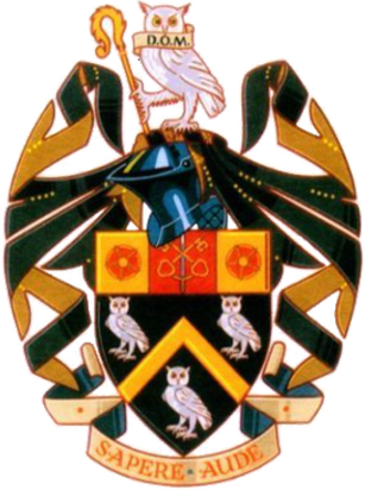 "Manchester Grammar School - Coat of arms of Manchester Grammar School, being a difference of the canting arms (""owl-dham"") of Hugh Oldham (d.1519), Bishop of Exeter, founder of The Manchester Grammar School and Corpus Christi College, Oxford. The chief displays the arms of the See of Exeter"