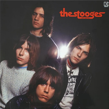 2020 reissue album cover showing the faces of the four group members