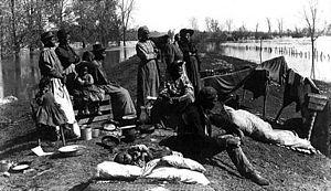 Exodusters - Refugees on Levee, 1897