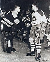 Richard, with blood on his face, shakes hands with goaltender Jim Henry, who is hunched forward in a slight bow
