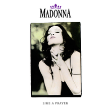 Madonna with her hands folded in prayer