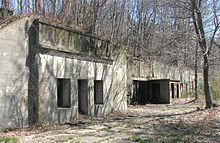 A photo of a concrete casemate or bunker.