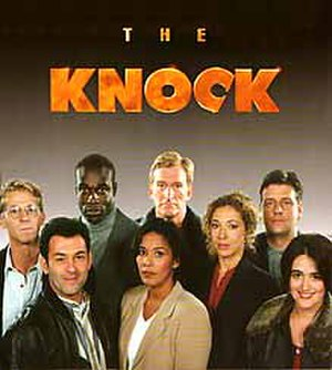 The Knock - (L to R: The show's main cast in Series Two — Marston Bloom, Enzo Squillino Jr., Steve Toussaint, Caroline Lee Johnson, Malcolm Storry, Alex Kingston, Andrew Dunn and Tracey Whitwell.)