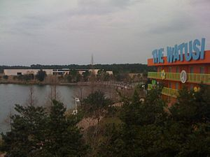 Disney's Art of Animation Resort - An incomplete Pop Century Legendary Years building can be seen across the Hourglass Lake. The Generation Gap Bridge would have connected both halves of the resort.