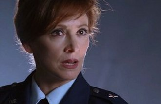 Diane Beckman - Wendy Makkena as the National Intelligence Director.