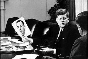 David E. Bell - President Kennedy with a picture of Bell