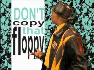 "Don't Copy That Floppy - The ""Disk Protector"" showing the title of the campaign during the rap portion of the video."