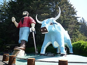 Paul Bunyan - Paul Bunyan (49 foot) and Babe the Blue Ox (35 foot) statues at Trees of Mystery. Note the size of the visitors at Babe's hoof.