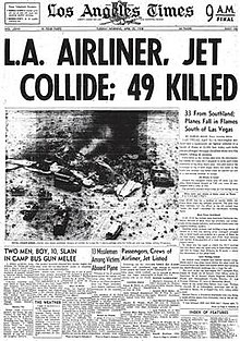"Newspaper front page. Headline states in large font ""L.A. AIRLINE, JET COLLIDE; 49 KILLED. An aerial photo of the desert crash site is immediately below the headline. The photo shows emergency vehicles surrounding shattered and burned wreckage from which dark smoke rises."
