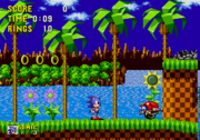 A typical in-game screenshot of Sonic The Hedgehog, taken from its first level, Green Hill Zone (Act 1).