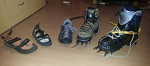 Climbing shoe - L-R: Two rock climbing shoes, an approach shoe, a leather boot and a plastic mountaineering boot, last two with automatic crampons