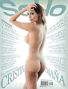 Front cover of SoHo featuring in the centre Colombian actress Cristina Umaña posing nude wearing epaulettes and a bicorne drawing a sword from its scabbard.