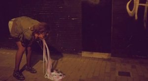 We Found Love (music video) - A screenshot of Rihanna vomiting pink and white streamers.