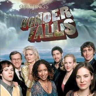 Wonderfalls - Promotional photo. Left to right: Neil Grayston, William Sadler, Diana Scarwid, Tracie Thoms, Tyron Leitso, Katie Finneran, Caroline Dhavernas, Lee Pace