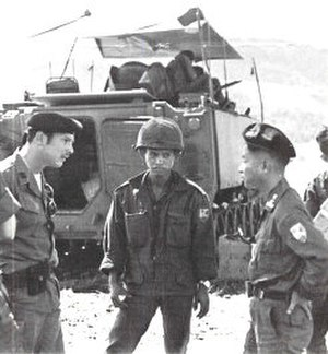II Corps (South Vietnam) - U.S. advisor (probably a MACV officer) confers with II Corps' 3rd Cav commander in front of an M113 APC.