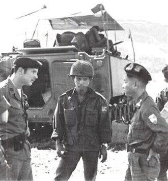 3d Armored Cavalry Squadron (South Vietnam) - U.S. advisor (probably a MACV officer) confers with an ARVN 3rd Cav commander in front of an M113 APC.