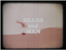 Title frame from film, with helicopter slinging a tranquilized bear
