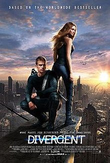 Lead characters Tris and Four stand above a futuristic Chicago.