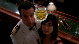 JAG (TV series) - Harm (David James Elliott) and Mac (Catherine Bell) use a challenge coin to determine who will resign his or her commission.