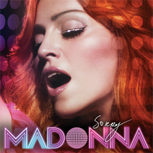 "Head-shot of a woman with fiery red hair. Her face is turned to the right and her mouth is a little open and eyes closed. Beneath her face the word ""MADONNA"" is written in capital font in pink and white lines. Above it, the word ""Sorry"" is written in thin white flowing scripts."