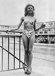 63031c15580 Micheline Bernardini modeling Réard's bikini at the Piscine Molitor on 5  July 1946. Reard's design was small enough to fit into a 5 by 5 by 5  centimetres ...